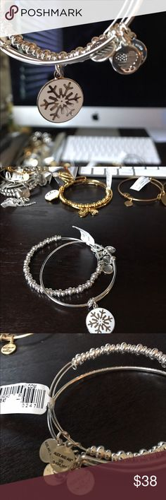 Alex and Ani bracelets Rare set of shiny silver Alex and Ani bracelets one is a beaded bracelet and the other is a snowflake ❄️ beautiful set new with tags Alex & Ani Jewelry Bracelets