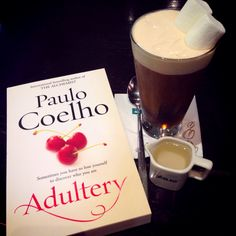 This is how I spend my afternoon. A glass of snowfall (sort of cappuccino with marshmallows on top) and a book from my favorite author Paulo Coelho #adultery