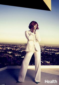Feminine power: Like her sultry Mad Men character Joan Harris, Christina channeled her feminine power in this white pantsuit Childfree