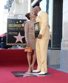 Steve Harvey receives kiss from wife during Walk of Fame ceremony.