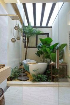 "Here's a way that you could get that interior ""courtyard"" feel into a small space. This is actually a bathroom shower, made into a garden with a tub. How cool is this?!"