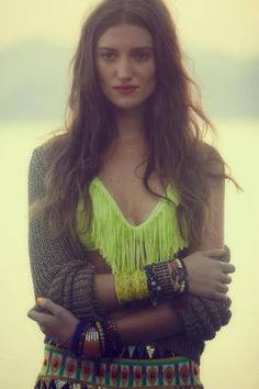 love the neon fringe and piles of bracelets