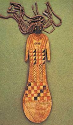 Photograph:The ancient Egyptian paddle doll has hair of clay beads.