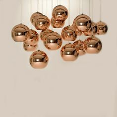 Tom Dixon Copper Shade.  SO pretty!  Too bad they cost $425 each.  What?! That's crazy talk!
