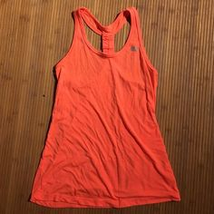 Neon orange workout tank Super comfy and lightweight. Neon orange color. Perfect for running. Only wore it a couple of times. Size small and fits true to size :) Tops Tank Tops