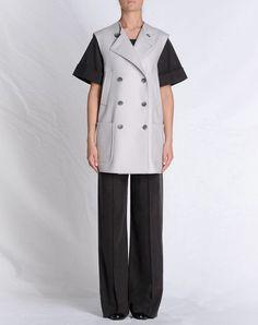 Mid-length jacket with removable sleeves and removable collar. Martin Margiela, one of my favorite designers.