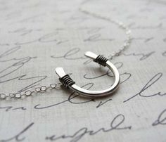 Horseshoe Necklace Uncovet.com Really love this for horse lovers.