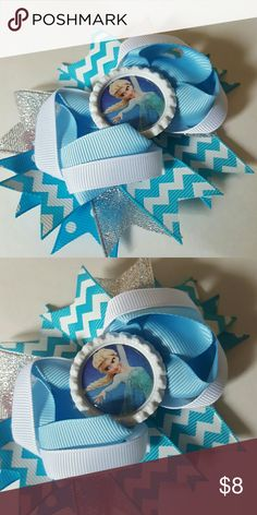 Elsa Frozen Hairbow Brand new. 4.5 inches.  Blue, silver, and white glitter chevron hairbow comes on an alligator clip.   Bundle and save!  Spend  $50 before shipping and get a FREE gift! Accessories Hair Accessories