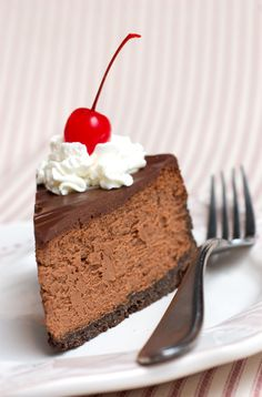 Incredible Triple Chocolate Cheesecake - I think that this may be my next attempt at a baked cheesecake @Lyndall Jewiss