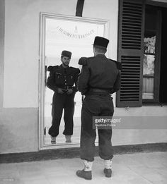 Soldier From French Foreign Legion In Uniform Looking In The Mirror During The…