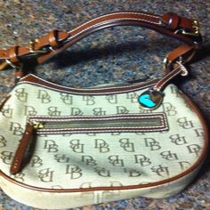 68b9bf03f930 Dooney and Burke small purse Brand new Dooney and Burke purse with pink  interior. Never worn or used. Bags