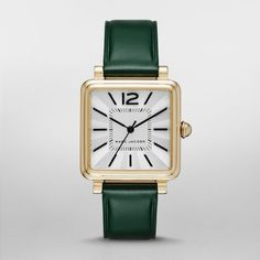 Sale 	 	Vic Green Leather and Gold-Tone Three-Hand Watch Make a strong style statement in the squared-off dial of the gold-tone Marc Jacobs Vic watch, featuring polished black stick indexes, MJ logo and a finely etched guilloche outer dial. A decadent green leather strap completes the bold look.