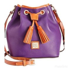 """💯% Authentic Dooney & Bourke purse 🛍Price firm🛍 100% Authentic💋💋Purple Dooney & Bourke purse. ** Price is firm** Drawstring handle to close the top. Signature red inside the purse. Yes it authentic. Dust bag and paperwork included.                        W 8"""" x L 9"""" One inside zip pocket. Two inside pockets. Cell phone pocket. Adjustable strap. Lined. Feet. Drawstring closure. Strap drop length 10.50"""". Dooney & Bourke Bags Shoulder Bags"""