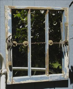 For the garden ... and old window with mirror replacing the glass, barbed wire strung across and old garden tools added (great to hang on a privacy fence for reflection from the garden)