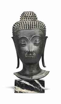 A BRONZE HEAD OF BUDDHA THAILAND, AYUTTHAYA PERIOD, 17TH CENTURY Cast with serene expression, incised downcast eyes below arched eyebrows, with elongated earlobes and tight curled hair rising into an ushnisha, on marble stand 10 5/8 in. (27 cm.) high