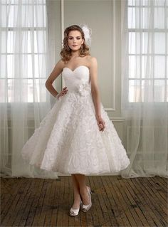 Go non-traditional for your big day with a tea-length wedding gown