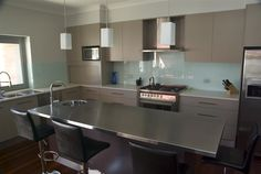 use stainless steel to good effect in your bespoke kitchen