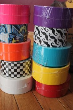 Use different colors of duct tape for different rooms when packing for a move.
