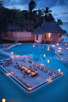 Spectacular lagoon-style pool, complete with bridges, water slide, and a sunken #dining area