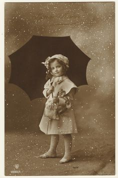 PORTRAIT OF A LITTLE GIRL IN A STUDIO SNOWSTORM