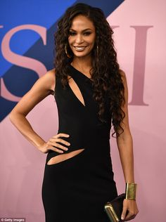 Top model: Joan Smalls donned a long black dress with cutouts Monday at the CFDA Fashion Awards at the Hammerstein Ballroom in New York City