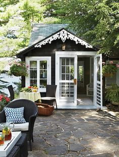 small garden hideaway...love the detail work under the eaves