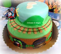 Thomas Train Cake - I like the idea of the two levels. I can't do fondant, so I'd have to come up with something else.