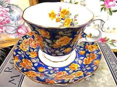 ROYAL ALBERT TEA CUP AND SAUCER GLAMIS CHINTZ BLUE AND ROSES TEACUP PATTERN