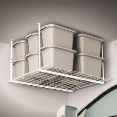 HyLoft W x D White Steel Overhead Garage Storage at Lowe's. The HyLoft 45 in. x 45 in. white Ceiling Storage Unit provides organization for your garage, basement, or attic, freeing up valuable floor space. Garage Ceiling Storage, Garage Storage Racks, Overhead Garage Storage, Garage Storage Solutions, Storage Bins, Diy Storage, Outdoor Storage, Storage Spaces, Garage Organization