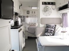 Love the black and white.  The wall-attached headboard is so clever.