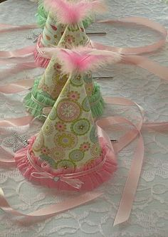 homemade party hats with scrapbook paper, feathers, ribbon, etc