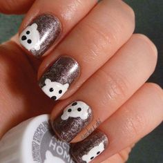 It's never a bad time for Coca-Cola, nor is it ever a bad time to style your nails after their adorable mascot, the polar bear. This design uses a sparkly brown base (like the popular beverage) and incorporates the polar bears playfully. To create cute heads like these, paint white half circles where you want the polar bear to be and two small dots for the ears. Then add two small black dots and a slightly bigger dot for the nose. Be sure to alternate your placements of each one to emulate…
