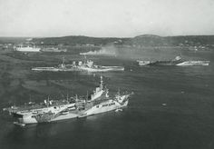 Trincomalee Harbour, Ceylon; February 1944. HMS Unicorn is in the foreground, with cruiser HMS Renown and carrier HMS Illustrious immediately behind.