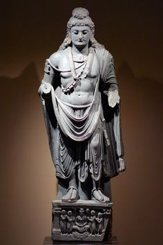 Bodhisattva Maitreya, 2nd-3rd century, Pakistan: Ancient Gandhara, schist.  Maitreya is a bodhisattva who is regarded as a future Buddha and successor to the historic Sakyamuni Buddha. Maitreya is typically depicted as seated, but Gandhara was widely known for production of standing Buddhist sculptures during this period.  Made in Gandhara, in what is now Pakistan and Afghanistan, this sculpture reflects the international style that was present in this ancient kingdom. Gandhara was located…