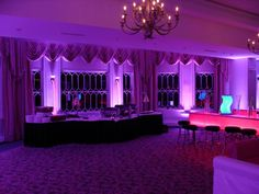 love all the purple uplighting and pink uplighting under the tables for this beautiful color table uplighting