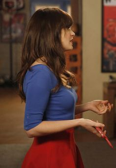 Blue half-sleeve top and red flared skirt on New Girl