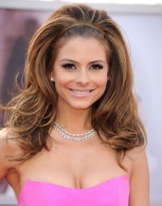 Maria Menounos's fun and girly style can be achieved with thick or thin hair, but Rokkan notes that it's easier for those with fuller locks. To get the actress's look, curl hair from roots to ends with a 2-inch curling iron. Pin up the top half of hair, tease up the section underneath the crown, then smooth the pinned portion back over the teased area.