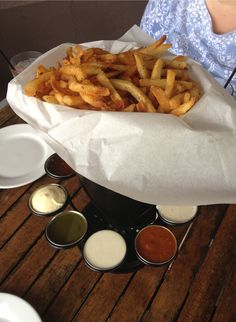 Brugge Brasserie - the pomme frittes are awesome! We split order between 3 people and couldn't finish. Comes with 12 dipping sauces - $12.95 - Broad Ripple Village - Indianapolis ( I recommend the Tripple Ripple house brew)