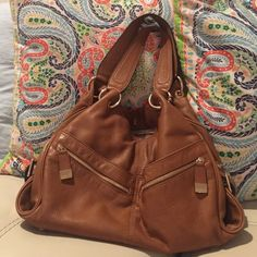 Authentic Michael Kors Leather Bag Almost as good as new. Beautiful brown color with gold accents. 6 pockets on the outside, three sections in the middle. The middle section zips close then all three section close by magnetic closure. If you are a person who carries a lot and loves pockets and origination then this bag is for you! MICHAEL Michael Kors Bags Shoulder Bags