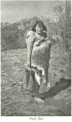 """Mujer Ona"" Outdoor portrait of a Selk'nam woman, posed wrapped in a guanaco hide, holding a hide (?) container for water. Path, field, brush and woods in the background Culture/People: Selk'nam (Ona) Date created: circa 1930 Photographer: Father Alberto Maria De Agostini, 1893-1960 Southern Cone, Australian Aboriginals, Melbourne Museum, Native American Photos, Outdoor Portraits, American Spirit, South America, Central America, Latina"