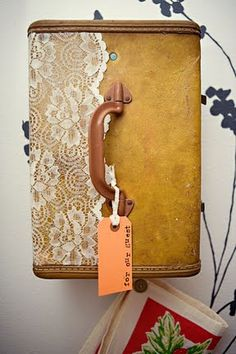 mod podge lace onto old suitcase (i need to try this one!)