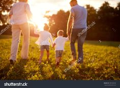 Blurred background of family in nature, back view