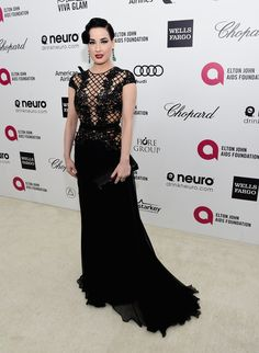 Dita Von Teese brought her usual vintage elegance to Elton John's annual Oscars bash in a black gown and emerald jewels.