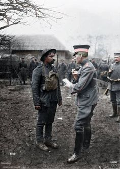 Battle of the Lys, April 1918. A Portuguese prisoner being examined by a German officer in Fourmies concentration camp.