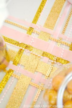 Weave ribbon on a table instead of a table runner or table cloth! Gold and Pink bridal shower via Kara Allen KarasPartyIdeas.com