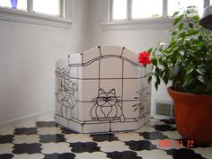 LOVE this privacy screen for kitty's. I will probably decoupage's one