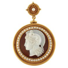 Archaeological Gold, Hardstone Cameo and Split Pearl Pendant-Brooch, Luigi Rosi   The circular hardstone cameo depicting the profile of a stylized warrior, encircled by two strands of rope-twist gold and split pearls, within a recessed frame of circle links flanked by rope-twist strands of gold, suspended by a concave flower centering one button pearl within two rows of articulated petals, circa 1870, approximately 23.8 dwt.
