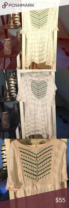 free people top New Romantics  top so cute for summer love the way it flows darling with flip-flops and cut off Jean shorts.    this is the tops that your girlfriend always wants to borrow from you for a first date Free People Tops Tunics