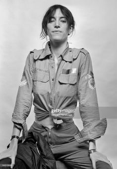 Studio portrait of Patti Smith wearing a US air force shirt, Amsterdam, Netherlands, 9th October 1976.
