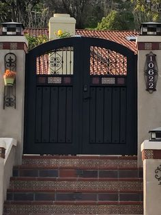 Garden Passages builds high quality Custom Wood Gates designed to enhance the look, feel and value of your home. Modern Spanish Decor, Double Gate, Tuscan Style, Decorative Tile, Spanish Style, Custom Wood, Dark Wood, Gates, Entrance